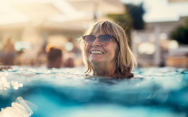 Resident enjoying the pool at Magnolia on the Green in Allen, Texas