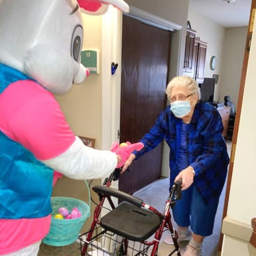 A resident with Easter Bunny at Madison House in Norfolk, Nebraska