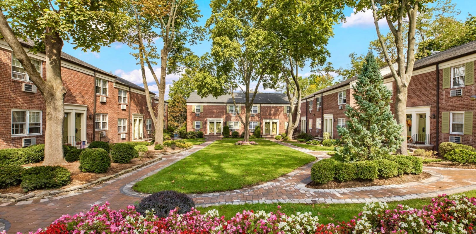 Beautiful brick exterior surround by a lush manicure landscape at General Wayne Townhomes and Ridgedale Gardens in Madison, New Jersey