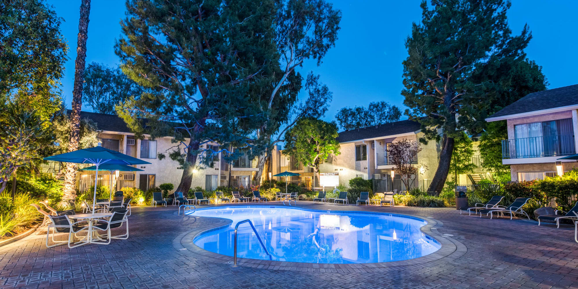 Dusk at the swimming pool area with the community's evening lights on at Village Pointe in Northridge, California