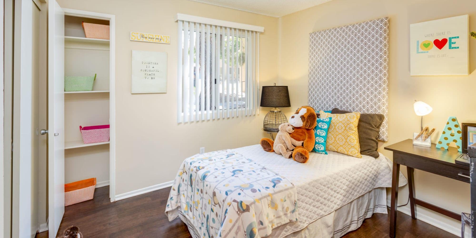 Children's bedroom with built-in closet shelving at Mountain Vista in Victorville, California