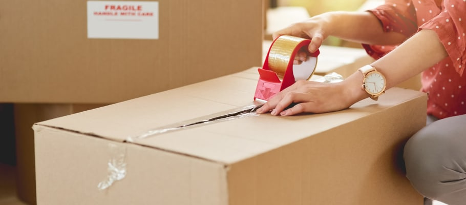 A box getting taped shut before it's stored at A-1 Self Storage in San Diego, California