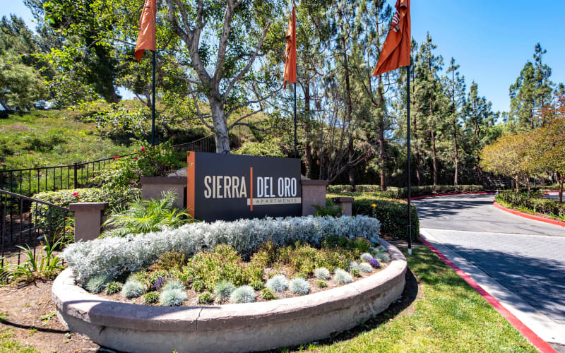 Landscaping around the monument sign at Sierra Del Oro Apartments in Corona, California