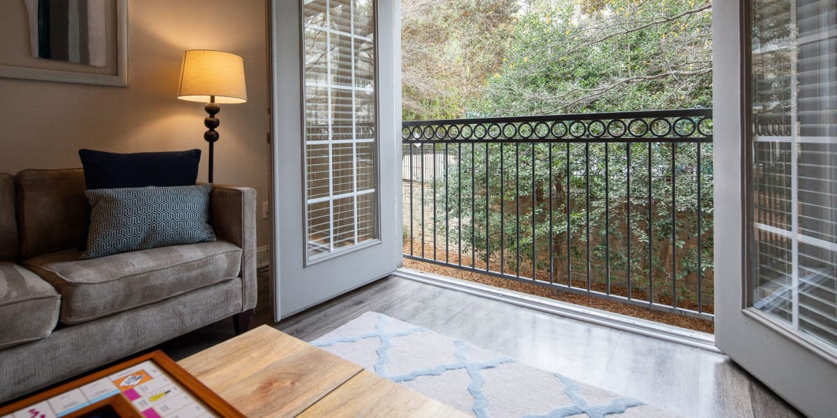 Living room with patio access at Marq Perimeter in Atlanta, Georgia