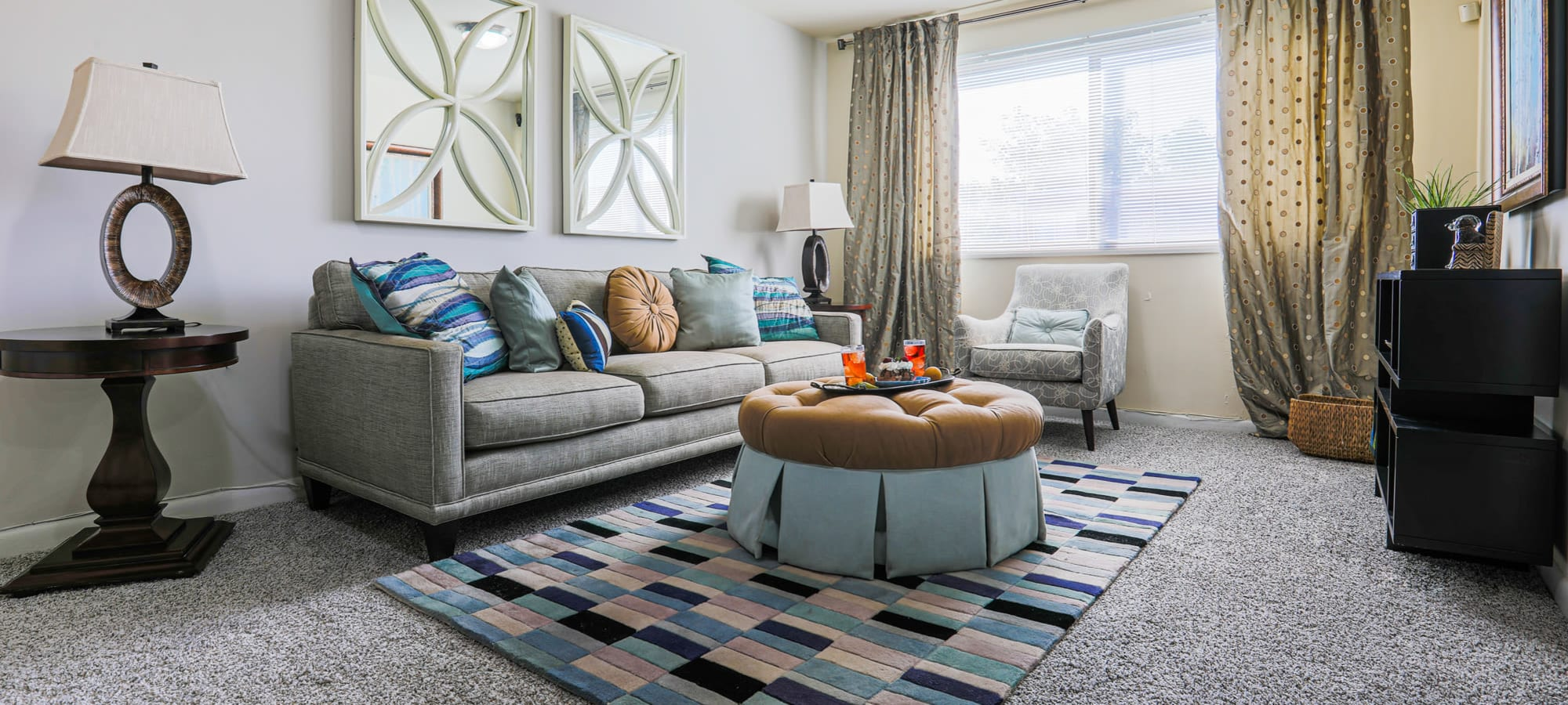 Model living room at Regency Pointe in Forestville, Maryland