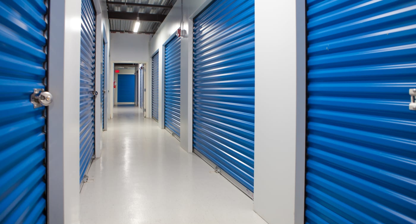 Interior units with blue doors at Atlantic Self Storage location in Saint Johns