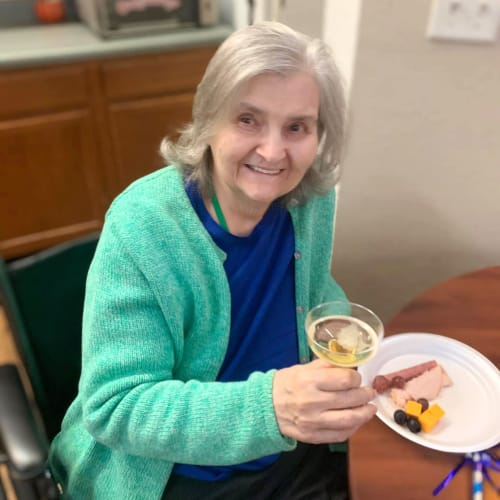 Resident with a meat and cheese platter at Canoe Brook Assisted Living in Broken Arrow, Oklahoma