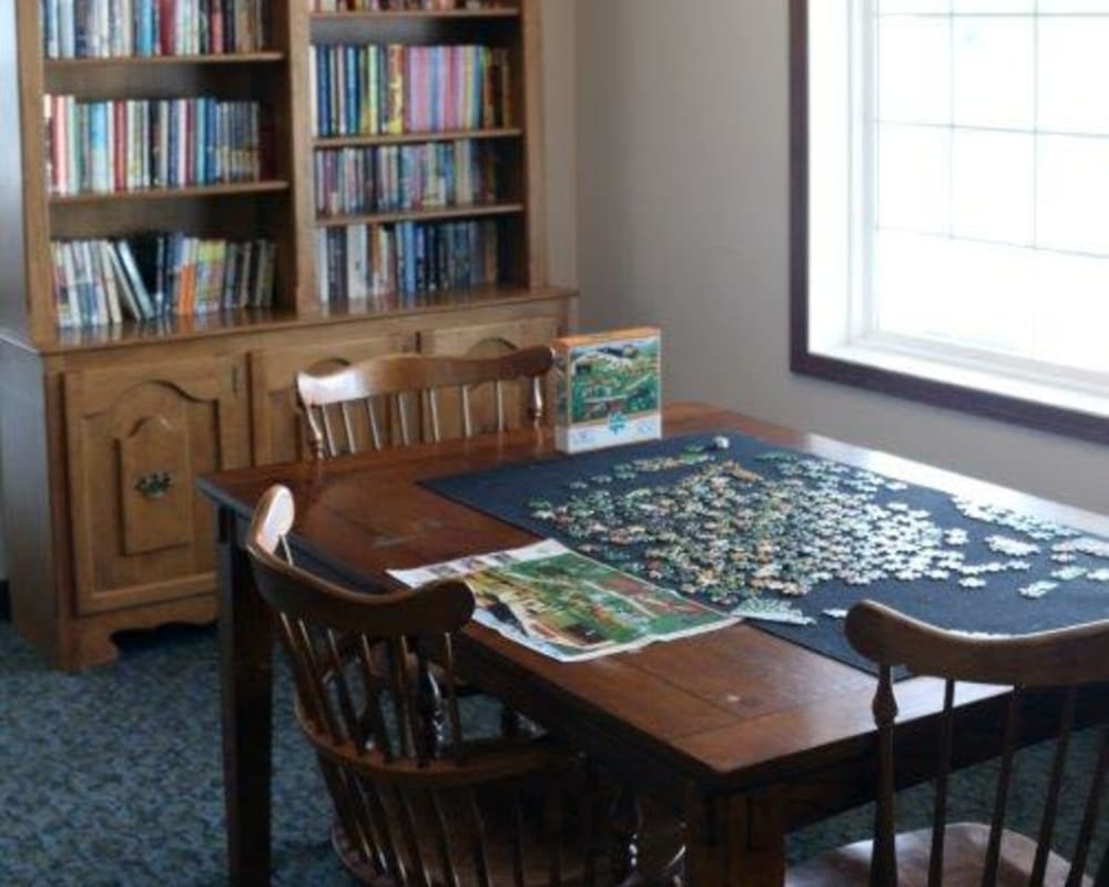 Activity room with a large, full bookshelf and games at Keelson Harbour in Spirit Lake, Iowa.