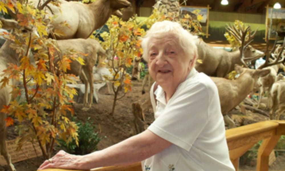Resident from Heritage Hill Senior Community looking at a butterfly exhibit in Weatherly, Pennsylvania