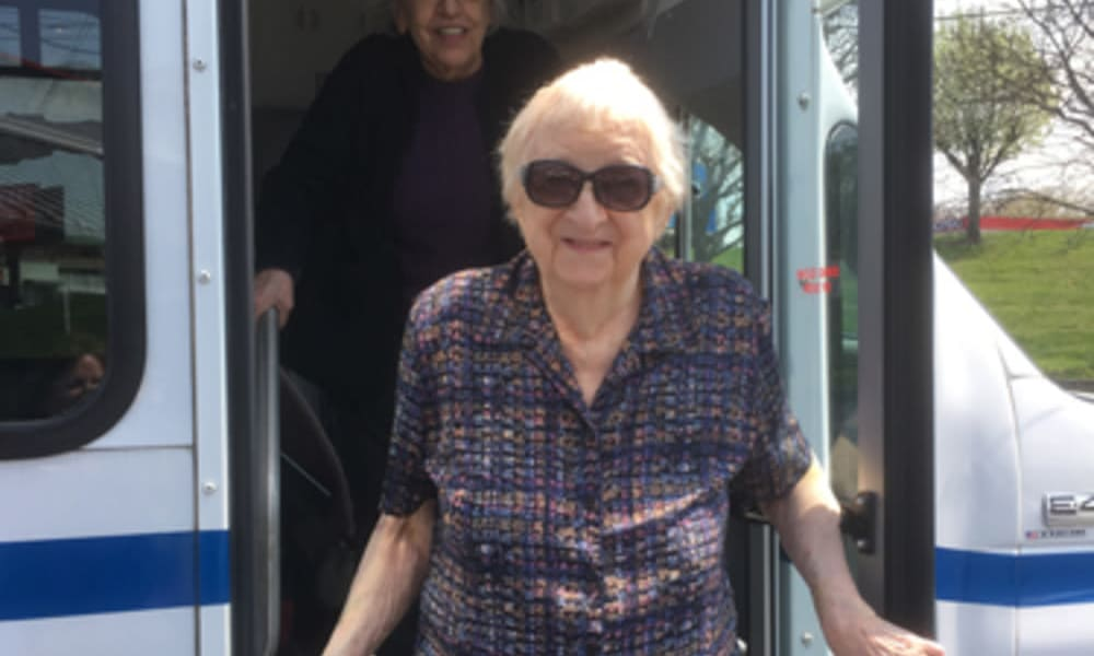 Resident getting off of a bus at Heritage Hill Senior Community in Weatherly, Pennsylvania