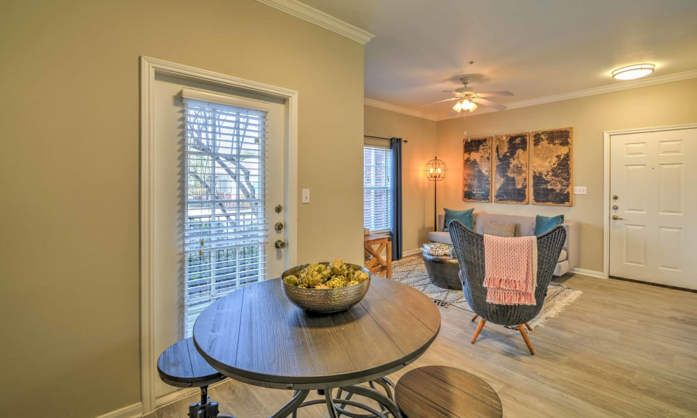 A cozy dining area in an apartment at The Atlantic Station in Fort Worth, Texas
