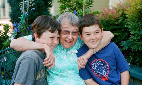 A resident and her grandchildren at Merrill Gardens.