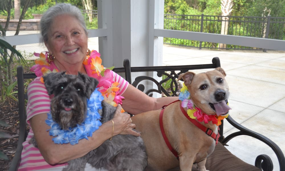 Resident and her dogs at Ashton Gardens Gracious Retirement Living in Portland, Maine