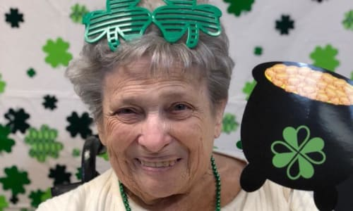 Resident celebrating St. Patrick's Day at Traditions of Cross Keys in Glassboro, New Jersey