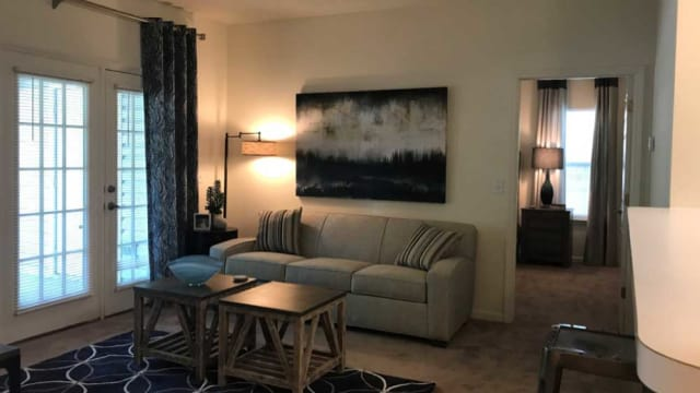Highbrook offers a naturally well-lit living room in High Point, NC