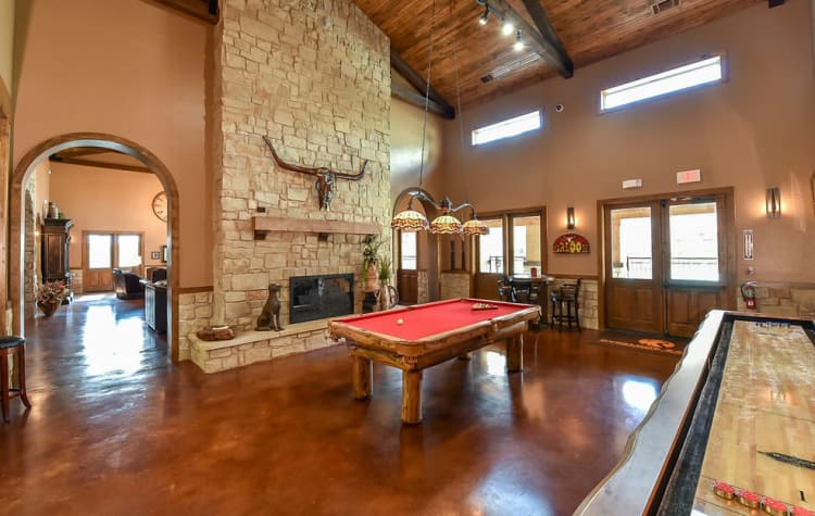 Interior of the luxurious resident clubhouse with plenty of lounge seating at Overlook Ranch in Fort Worth, Texas