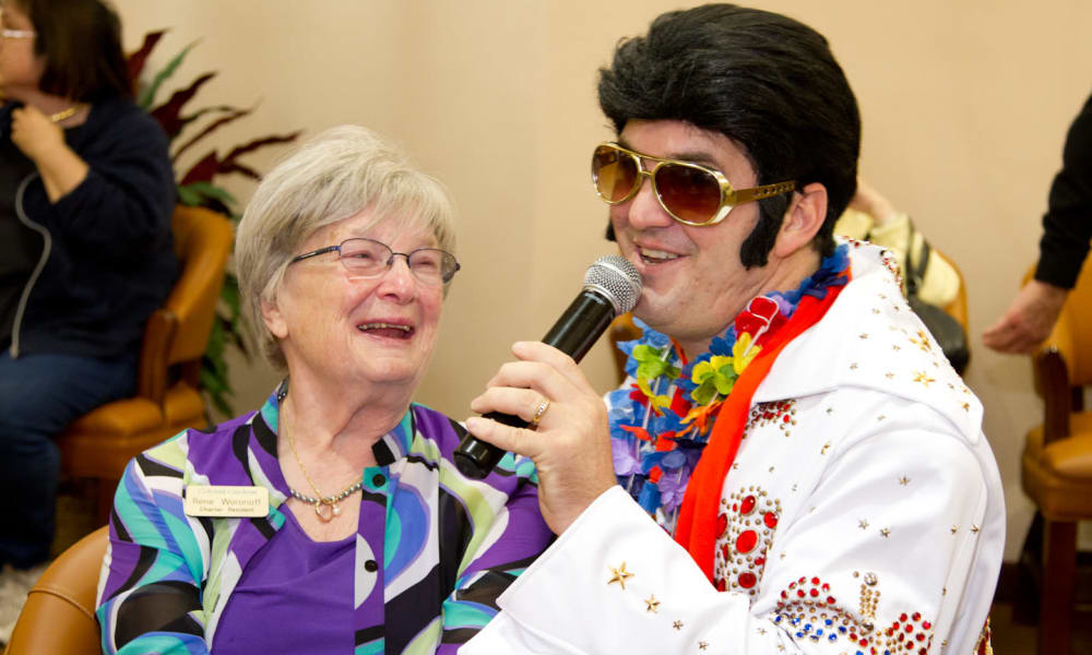 A resident from Chesterfield Heights in Midlothian, Virginia enjoying listening to an Elvis impersonator sing