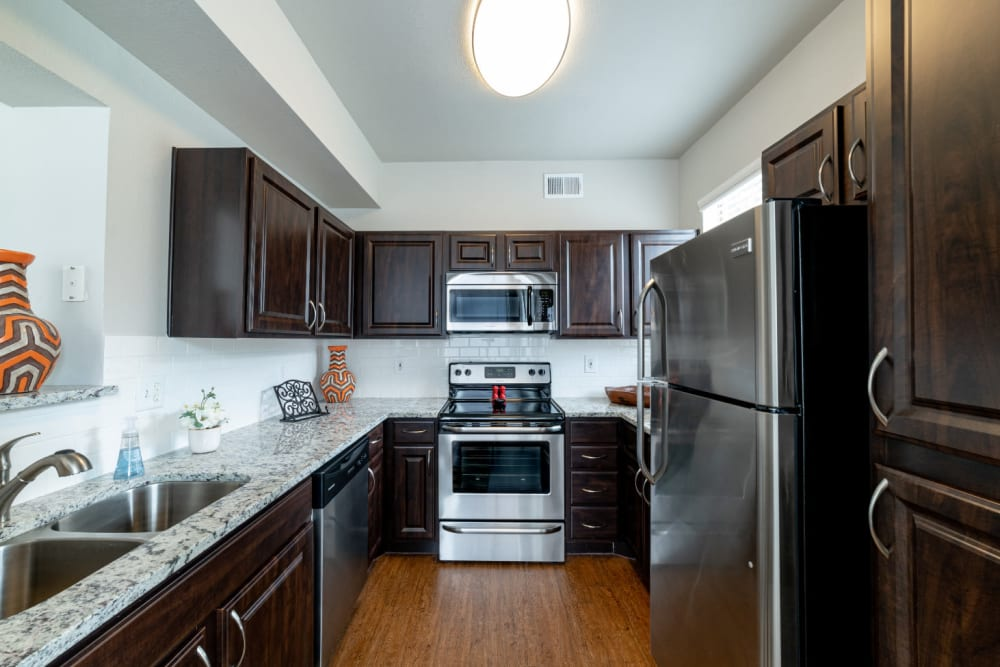 Kitchen with granite counters at Marquis at Lantana in Flower Mound, Texas