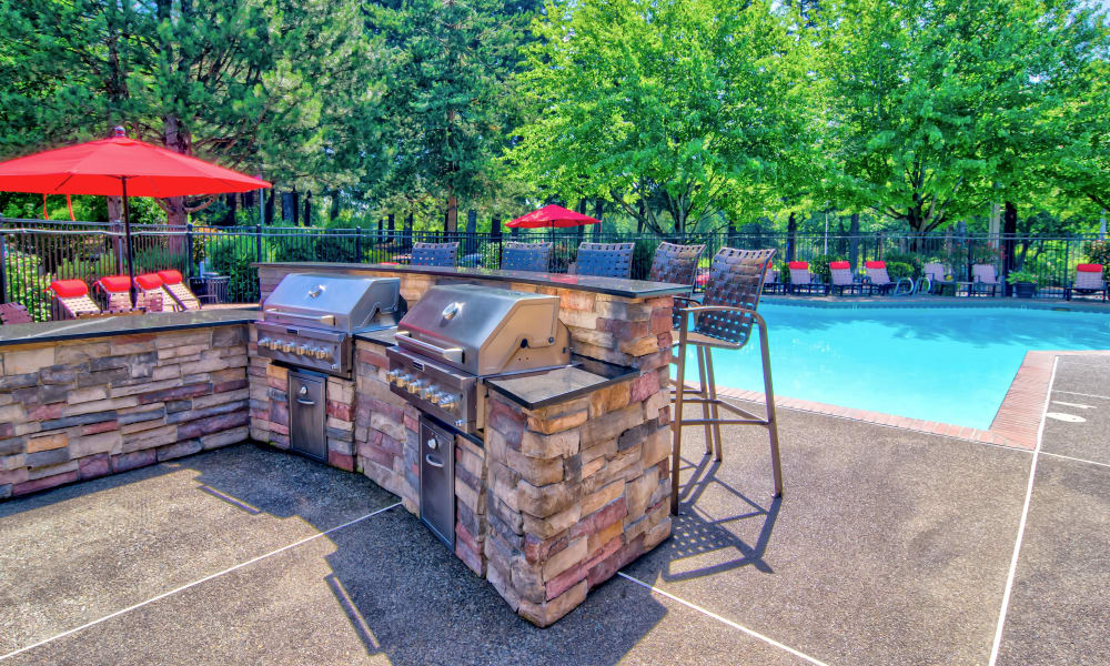 BBQ area near the pool at Vista at 23 Apartments in Gresham, OR