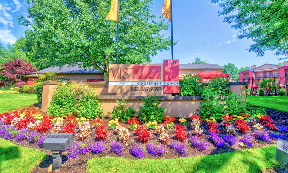Beautiful entrance sign garden at Vista at 23 Apartments in Gresham, OR