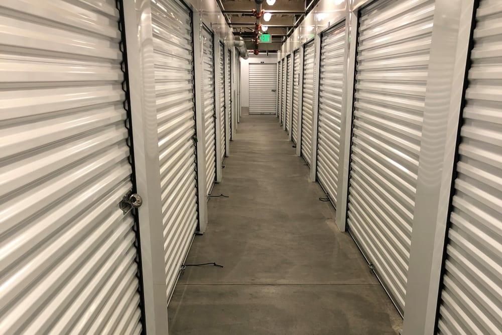 A hallway of indoor storage units at Storage Etc... De Soto in Chatsworth, California