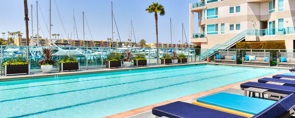 Swimming pool area on a beautiful day at Esprit Marina del Rey in Marina Del Rey, California