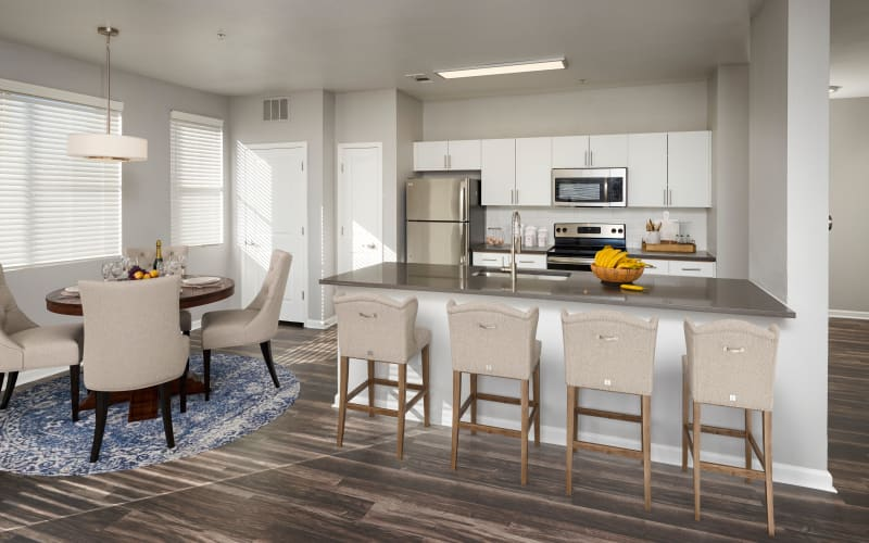 Spacious and bright dining room and kitchen at The Rail at Inverness in Englewood, Colorado
