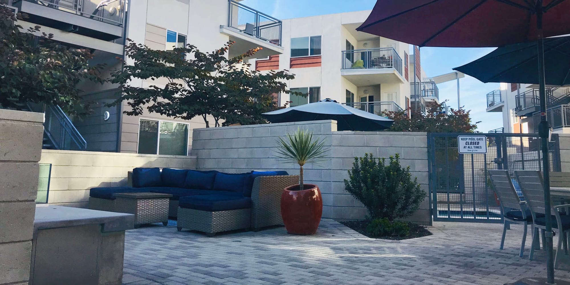 Lounge seating at one of the exterior courtyards near the pool area at Citron in Ventura, California