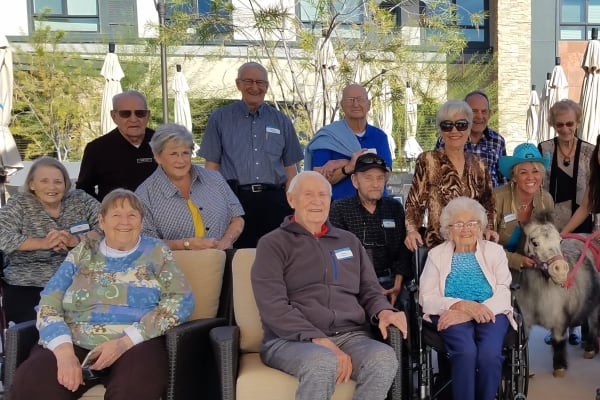 Residents pose for a picture at Merrill Gardens at Anthem in Anthem, Arizona.