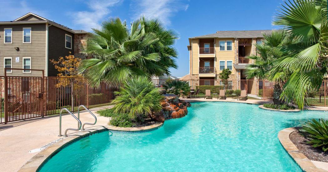 Swimming pool at Springmarc Apartments in San Marcos, Texas