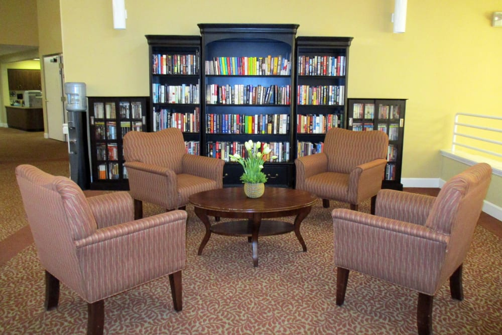 Large room with a bookcase at Woodside Senior Living in Springfield, Oregon
