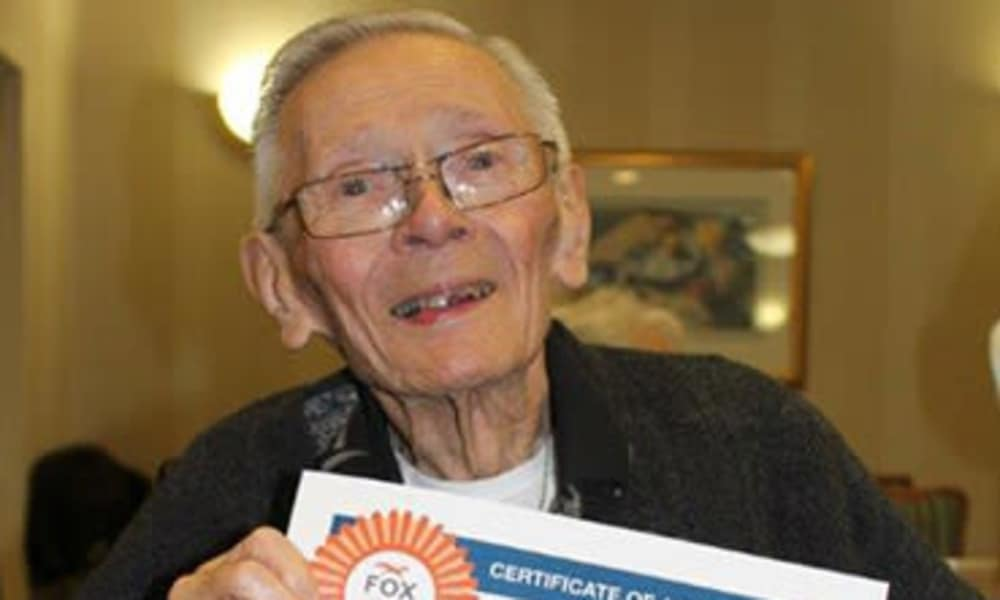 Resident at Chestnut Knoll presenting his award in Boyertown, Pennsylvania