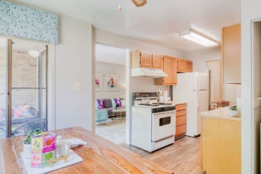 Kitchen with dining room at The Timbers at Long Reach Apartments in Columbia , Maryland