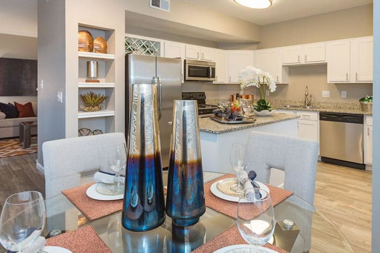 Dining room and kitchen view at Retreat at Cheyenne Mountain Apartments
