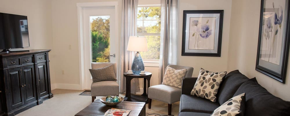 Stylish living room at The Springs at Greer Gardens in Eugene, Oregon