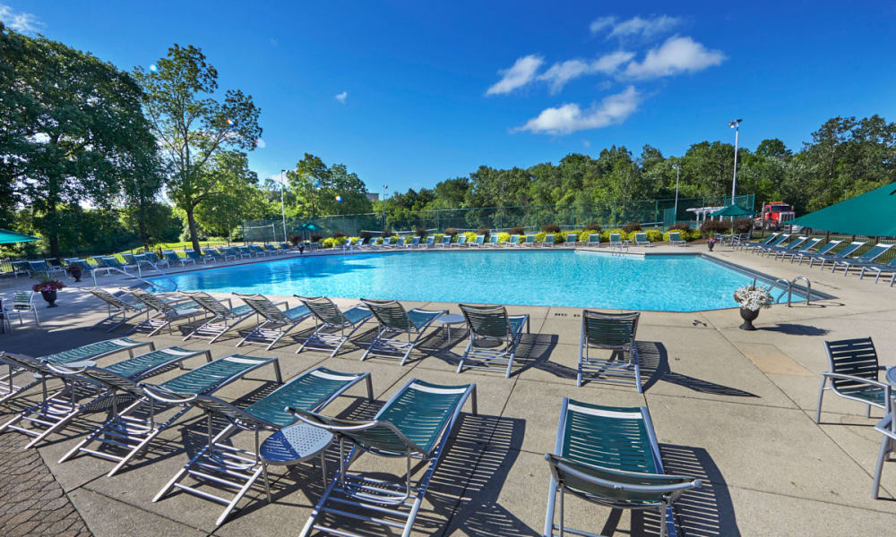 Shimmering swimming pool with sundeck on a sunny day at Muirwood in Farmington Hills, Michigan