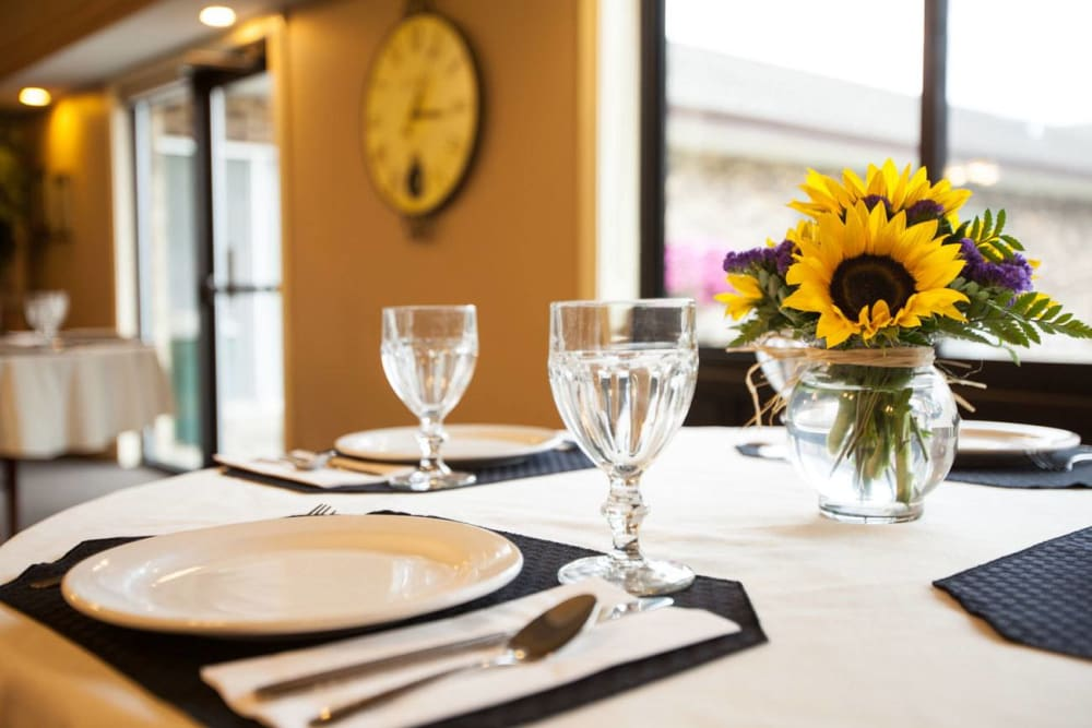 Dining table with sunflower decorations at White Oaks in Lawton, Michigan