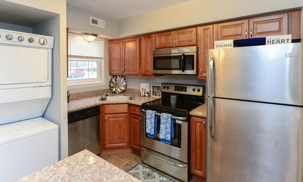 Kitchen featuring dark cabinetry at Moorestowne Woods Apartment Homes in Moorestown, NJ