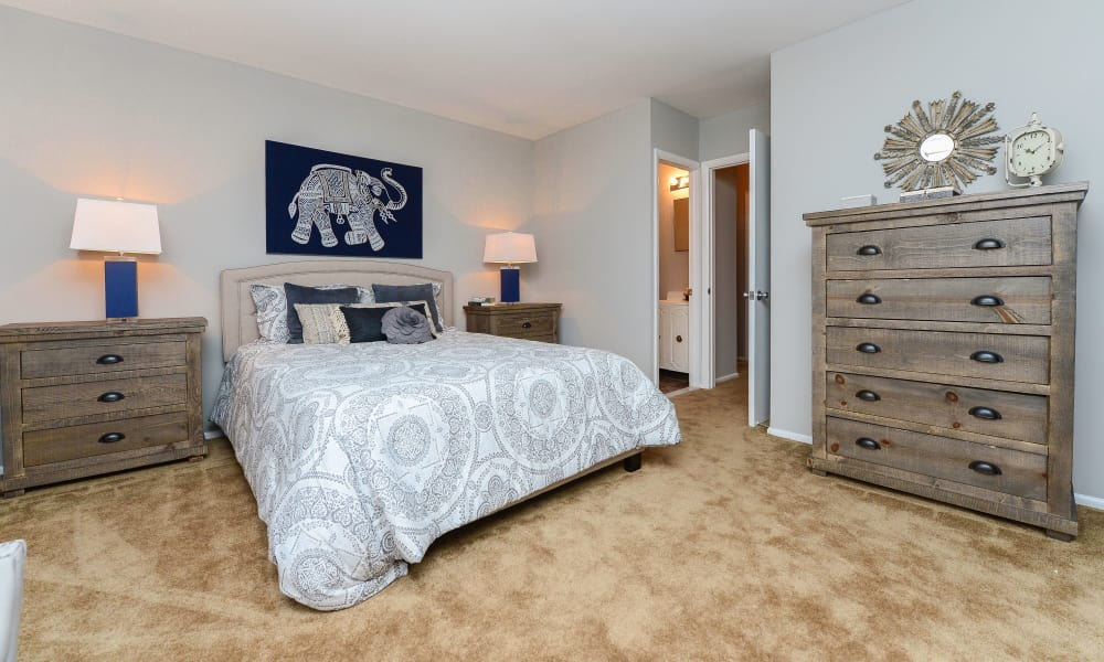 Well decorated model bedroom at Moorestowne Woods Apartment Homes in Moorestown, NJ