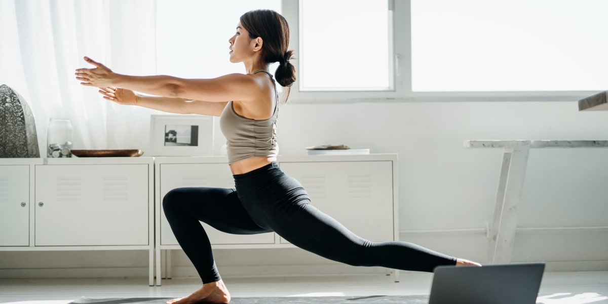 Resident doing yoga at Brooks on Preston in Plano, Texas