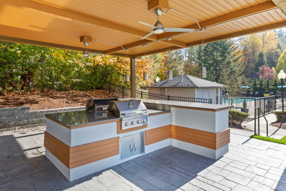 Covered grill and picnic area at Pebble Cove Apartments in Renton, Washington