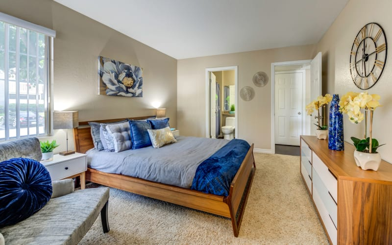 Spacious master bedroom with plush carpeting at Village Oaks in Chino Hills, California