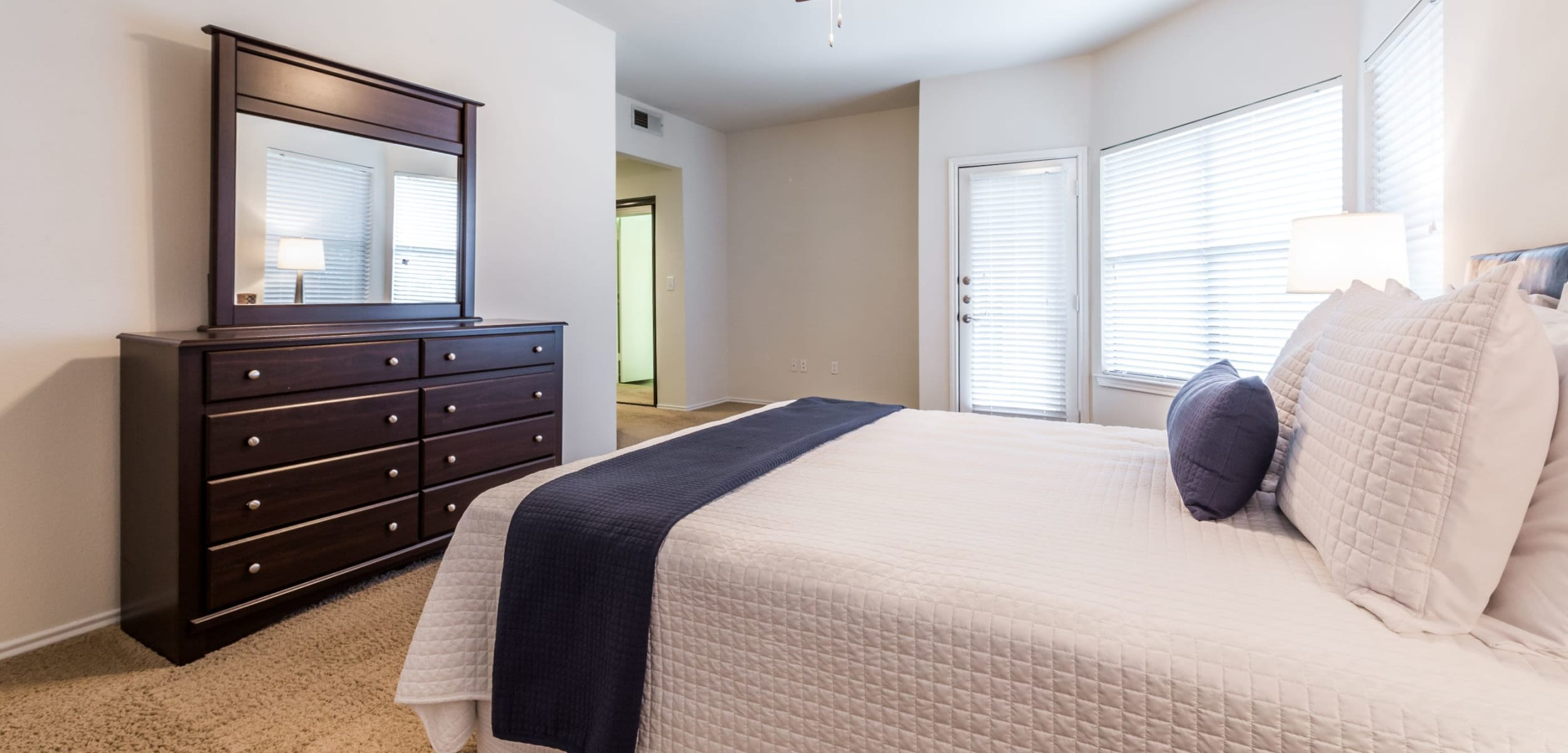 Bedroom with a large window at Marquis at Caprock Canyon in Austin, Texas