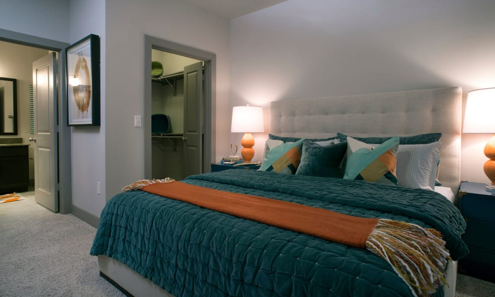 Resident bedroom with a walk-in closet at Savannah Oaks in San Antonio, Texas