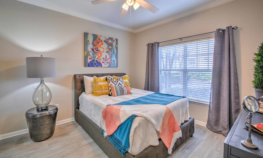 A spacious bedroom with a large window at The Atlantic Station in Fort Worth, Texas