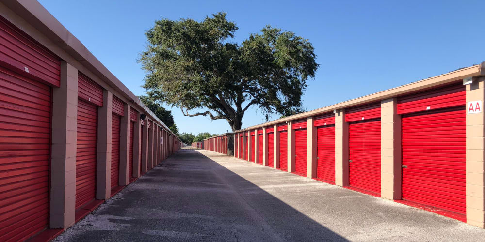 Drive-up access storage units with red doors at StorQuest Self Storage in Tampa, Florida