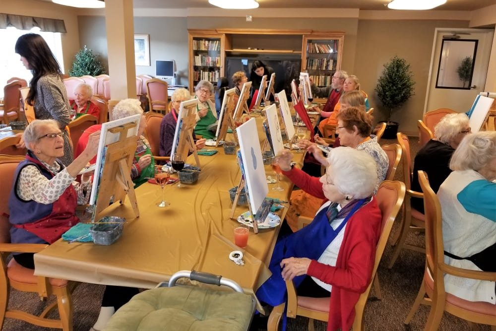 Residents painting at Merrill Gardens at Renton Centre in Renton, Washington.
