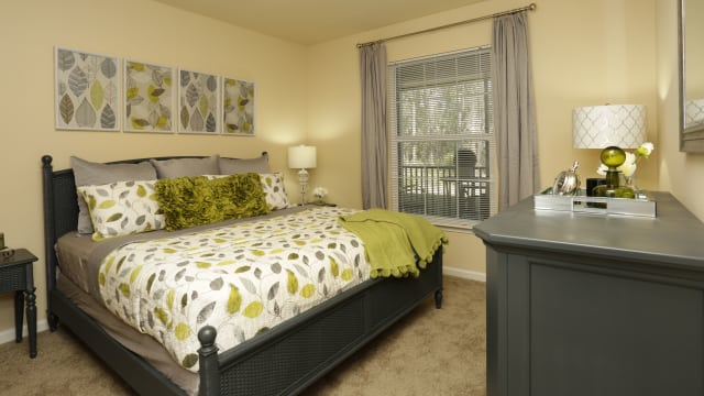 Bedroom at Palm Coast in Integra Woods