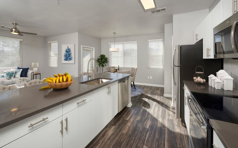 Renovated kitchen with white cabinets at The Rail at Inverness in Englewood, Colorado