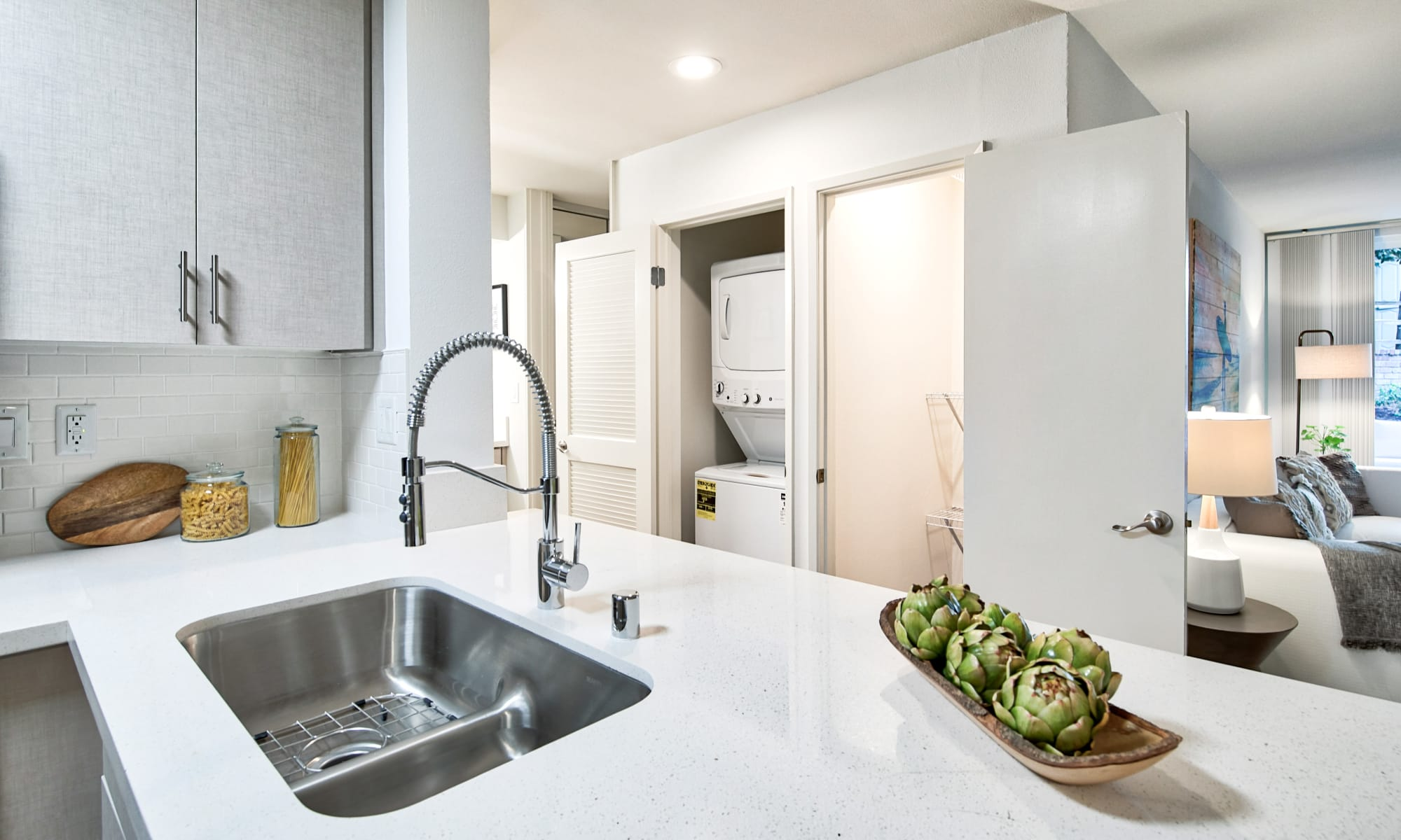 Model apartment's kitchen with stainless-steel appliances at The Meadows in Culver City, California